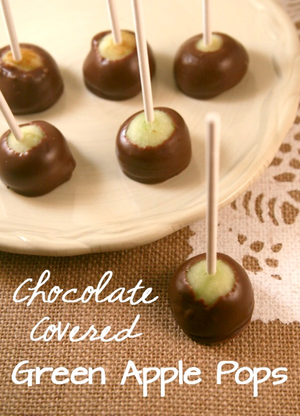 Chocolate Covered Apple Bites- These cute little apples on a stick are perfect for fall parties and get togethers. They are super easy to make, too!